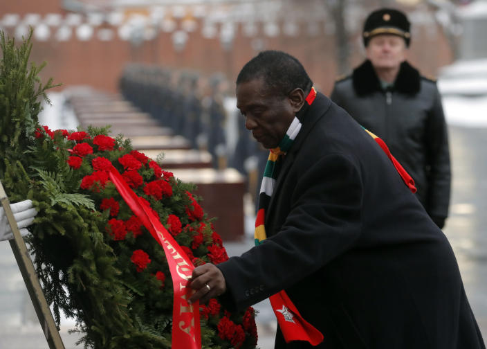 Zimbabwe's President Emmerson Mnangagwa, center, attends a wreath laying ceremony at the Tomb of the Unknown Soldier in Moscow, Russia, Tuesday, Jan. 15, 2019. The president of Zimbabwe, whose country is facing its worst economic crisis in a decade, is visiting Russia in hopes of securing long-term loans. (Sergei Ilnitsky/Pool Photo via AP)