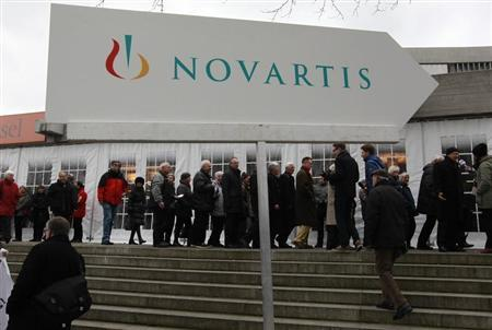 Shareholders queue to enter the St.Jakob Halle for Swiss drug maker Novartis annual general meeting in Basel