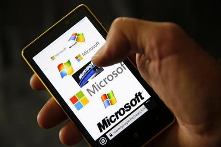 A Nokia Lumia 820 smartphone with Microsoft logos on the screen is shown in a photo illustration taken in the central Bosnian town of Zenica