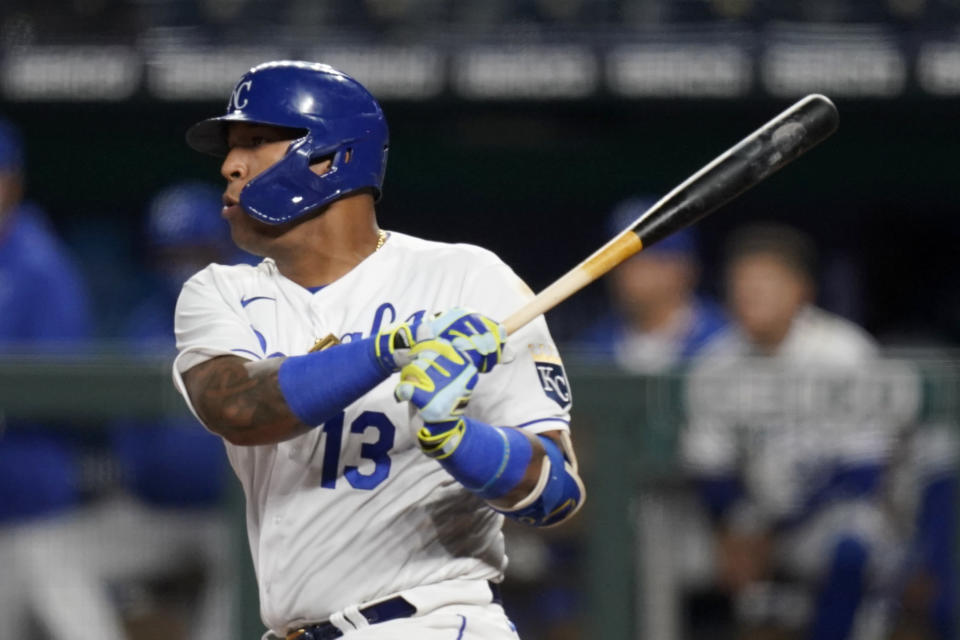 Kansas City Royals Salvador Perez get his 1000th career hit during the sixth inning of a baseball game against the Los Angeles Angels at Kauffman Stadium in Kansas City, Mo., Monday, April 12, 2021. (AP Photo/Orlin Wagner)