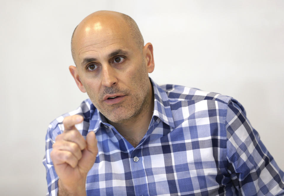 FILE - In this Monday, May 2, 2016, file photo, Jet.com CEO Marc Lore speaks during an interview in Hoboken, N.J. Wal-Mart's acquisition of Jet.com is accelerating its progress in e-commerce as it works to narrow the gap between itself and online leader Amazon. Wal-Mart is betting its online future on essentials like produce and groceries and has adjusted its shipping strategy. But Amazon keeps innovating too. (AP Photo/Seth Wenig, File)