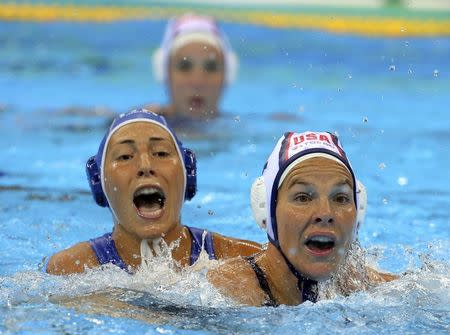 2016 Rio Olympics - Water Polo - Final - Women's Gold Medal Match USA v Italy - Olympic Aquatics Stadium - Rio de Janeiro, Brazil - 19/08/2016. Federica Radicchi (ITA) of Italy (L) and Kami Craig (USA) of USA compete. REUTERS/Laszlo Balogh