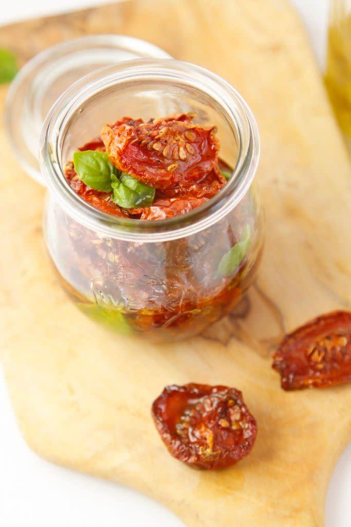 """<strong>Get the <a href=""""http://www.bellalimento.com/2014/04/01/oven-roasted-preserved-tomatoes/"""" rel=""""nofollow noopener"""" target=""""_blank"""" data-ylk=""""slk:Oven-Roasted Preserved Tomatoes recipe"""" class=""""link rapid-noclick-resp"""">Oven-Roasted Preserved Tomatoes recipe</a> from Bell'alimento</strong>"""