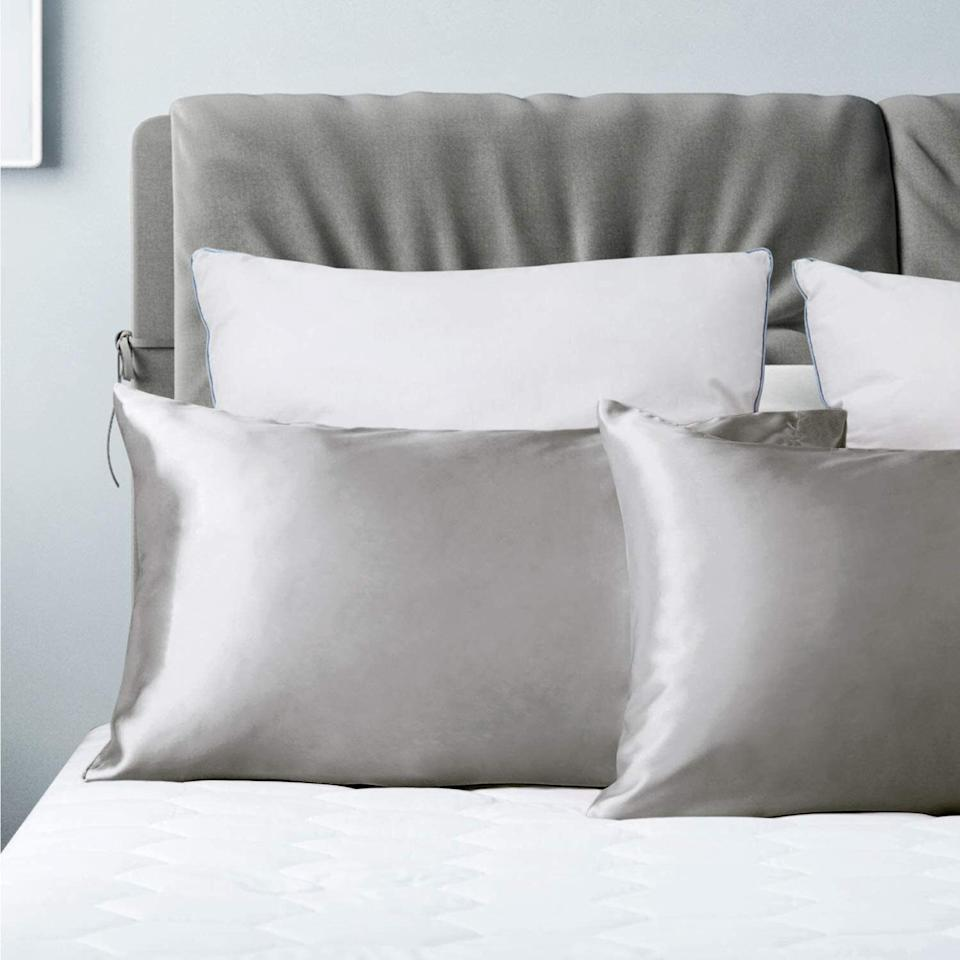 """They'll become an essential for anyone who sleeps hot and/or wants to keep their hair and skin moisturized. Soooooo, everyone?<br /><br /><strong>Promising review:</strong>""""I was originally looking for silk pillow cases, but decided to give these a try because they were a better price. I am not disappointed! I have seen a noticeable difference in my hair in the mornings and overall they are so smooth and comfortable to sleep on. I've washed them several times and haven't seen a difference in the quality. I would buy again."""" — <a href=""""https://www.amazon.com/gp/customer-reviews/R3SEN3NUFILJXV?&linkCode=ll2&tag=huffpost-bfsyndication-20&linkId=6deecb6ed8018caa89d0307a04649ee1&language=en_US&ref_=as_li_ss_tl"""" target=""""_blank"""" rel=""""noopener noreferrer"""">Kate</a><br /><br /><strong><a href=""""https://www.amazon.com/dp/B07PP933QX?th=1&linkCode=ll1&tag=huffpost-bfsyndication-20&linkId=ec518a5cc85cc4d05aeadebc8f32f6ad&language=en_US&ref_=as_li_ss_tl"""" target=""""_blank"""" rel=""""noopener noreferrer"""">Get a pack of two from Amazon for $8.99+(available in four sizes and 24 colors).</a></strong>"""