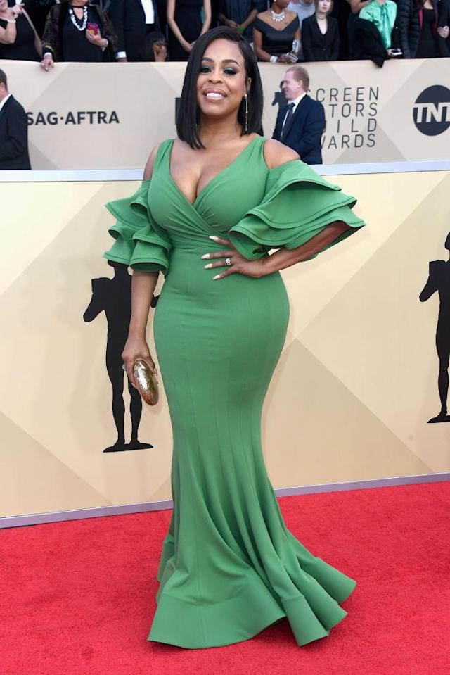 <p>Nash flaunted her curves in a fitted green dress with flared sleeves. (Photo: Getty Images) </p>