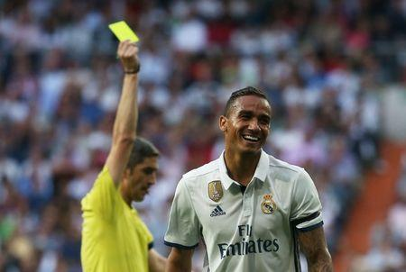 Football Soccer - Real Madrid v Sevilla - Spanish Liga Santander - Santiago Bernabeu, Madrid, Spain - 14/5/17 Real Madrid's Danilo is shown a yellow card by referee Alberto MallencoReuters / Sergio Perez