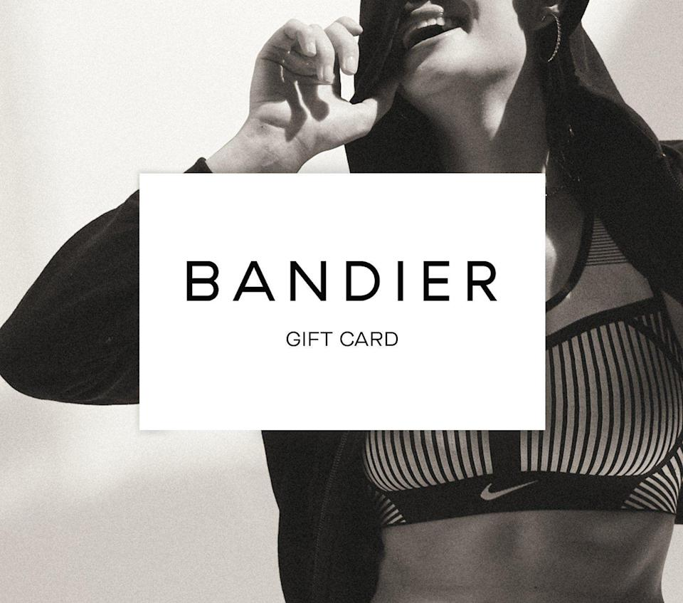 """<p><strong>BANDIER</strong></p><p>bandier.com</p><p><a href=""""https://go.redirectingat.com?id=74968X1596630&url=https%3A%2F%2Fwww.bandier.com%2Fproducts%2Fgift-card&sref=https%3A%2F%2Fwww.cosmopolitan.com%2Fstyle-beauty%2Ffashion%2Fg34229001%2Fbest-gift-card-ideas-to-give%2F"""" rel=""""nofollow noopener"""" target=""""_blank"""" data-ylk=""""slk:Shop Now"""" class=""""link rapid-noclick-resp"""">Shop Now</a></p><p>Whether they love being active or just love looking like they are, they'd love to shop this luxe athleisure wear from this store—on you, of course.</p>"""