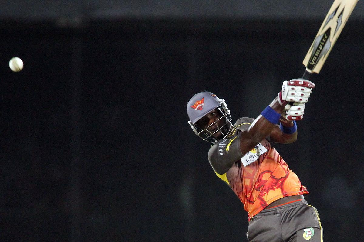 Darren Sammy of Sunrisers Hyderabad hits over the top during the eliminator match of the 2013 Pepsi Indian Premier League between The Rajasthan Royals and the Sunrisers Hyderabad held at the Feroz Shah Kotla Stadium, Delhi on the 22nd May 2013.(BCCI)