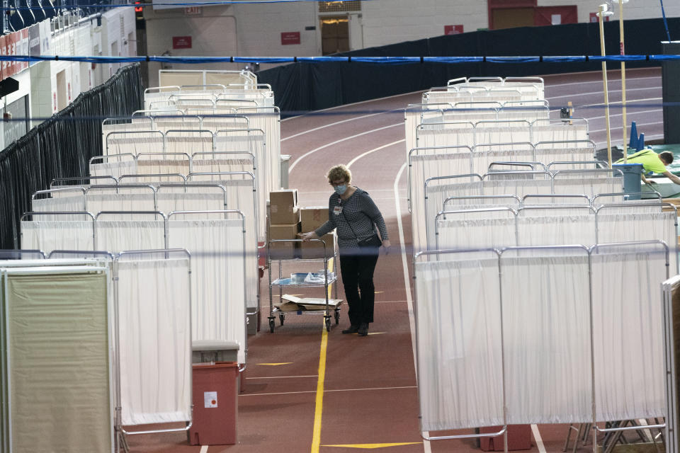 The Armory, an indoor track and field complex, is being set up as a COVID-19 vaccination center, Thursday, Jan. 14, 2021, in New York. The site is run by New York-Presbyterian Hospital and vaccinations are available by appointment through vaccinetogetherny.org. Up to 1,000 people per day can be inoculated at the site. (AP Photo/Mark Lennihan)