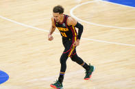 Atlanta Hawks guard Trae Young reacts after making a basket during the first half of Game 1 of a second-round NBA basketball playoff series against the Philadelphia 76ers, Sunday, June 6, 2021, in Philadelphia. (AP Photo/Matt Slocum)