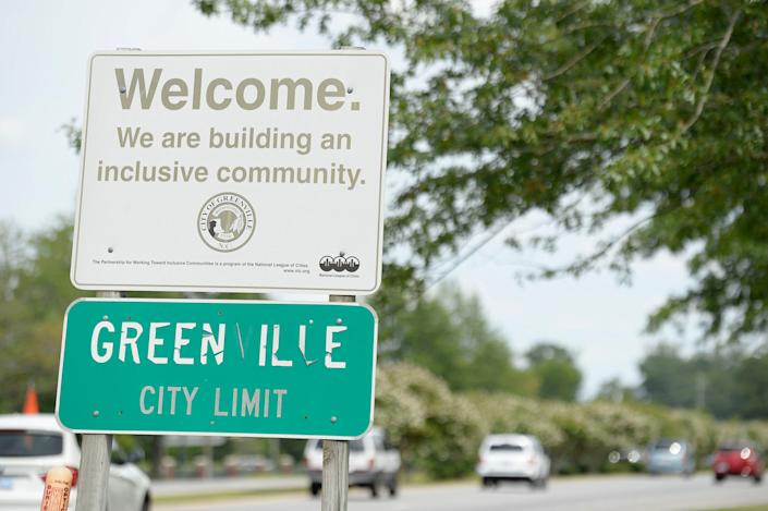 A welcome sign in Greenville, N.C., reads,