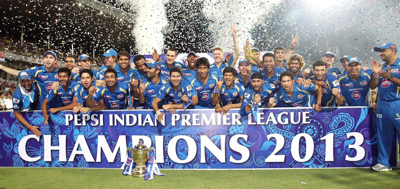 Mumbai Indians celebrate with the Pepsi Indian Premier League Trophy during the Final of the Pepsi Indian Premier League between The Chennai Superkings and the Mumbai Indians held at the Eden Gardens Stadium in Kolkata on the 26th May 2013.(BCCI)
