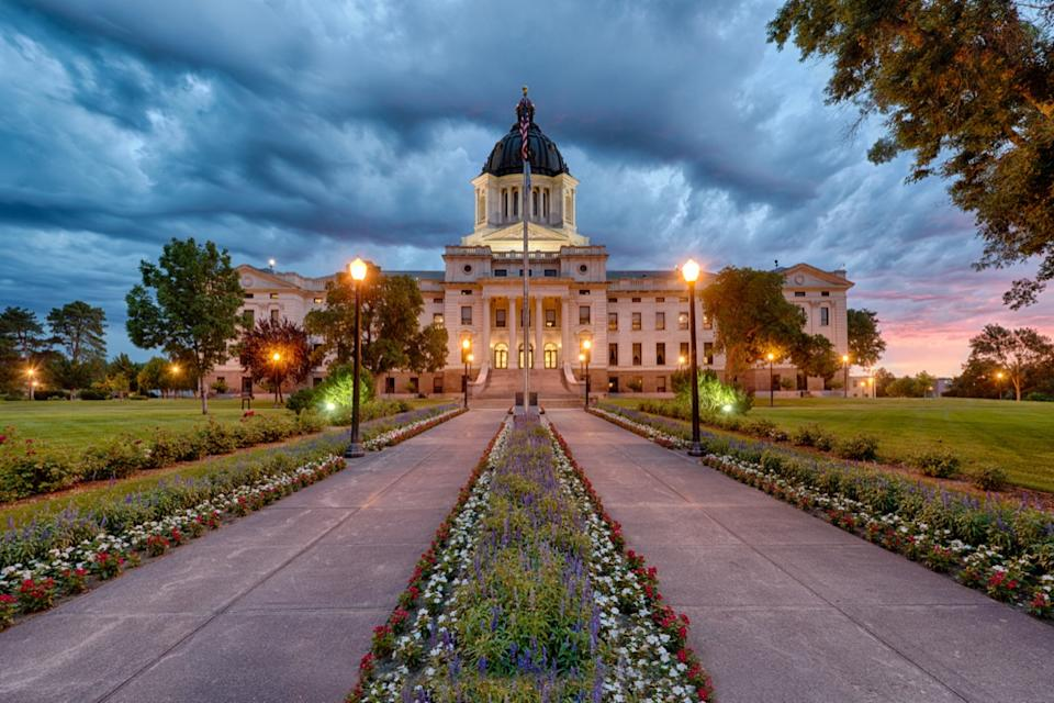A storm rolls in at dawn at the South Dakota State Capitol building in Pierre, South Dakota