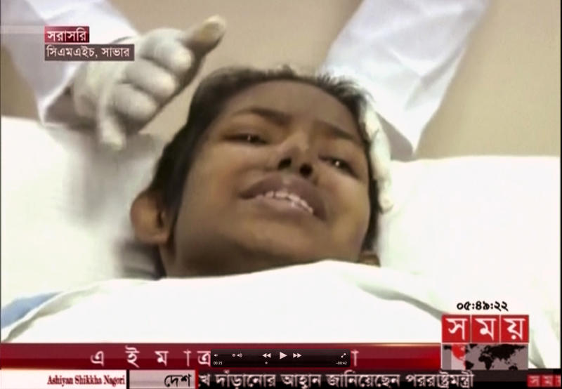 In this image made from a TV footage released by AP video, a woman survivor is examined on a hospital bed in Dhaka as she was rescued out of a collapsed building in Savar near Dhaka, Bangladesh, Friday, May 10, 2013. The woman buried in the wreckage of a collapsed garment factory building for 17 days was rescued Friday, a miraculous moment set against a scene of unimaginable horror where the death toll is more than 1,000 and still rising. (AP Photo/Somoy TV via AP Video) BANGLADESH OUT