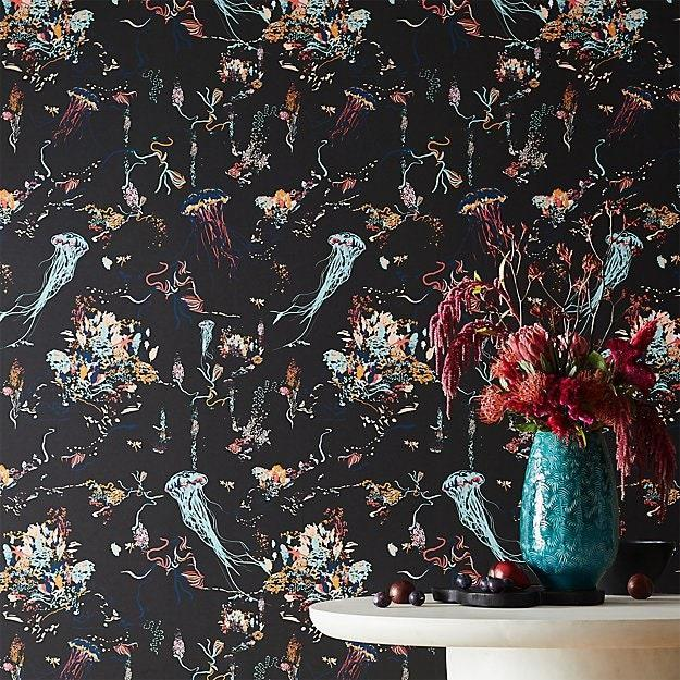 """Want to go coastal in the most unexpected way? Hang up this wallpaper with jellyfish and sea life. It's definitely not your average nautical pattern. This roll of wallpaper from CB2 is also available in black and white. $279, CB2. <a href=""""https://www.cb2.com/jellyfish-black-wallpaper/s520814"""" rel=""""nofollow noopener"""" target=""""_blank"""" data-ylk=""""slk:Get it now!"""" class=""""link rapid-noclick-resp"""">Get it now!</a>"""