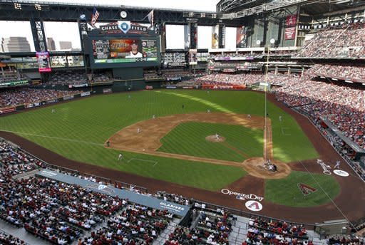 The Arizona Diamondbacks and San Francisco Giants compete in the first inning of an opening day baseball game, Friday, April 6, 2012, in Phoenix. (AP Photo/Matt York)