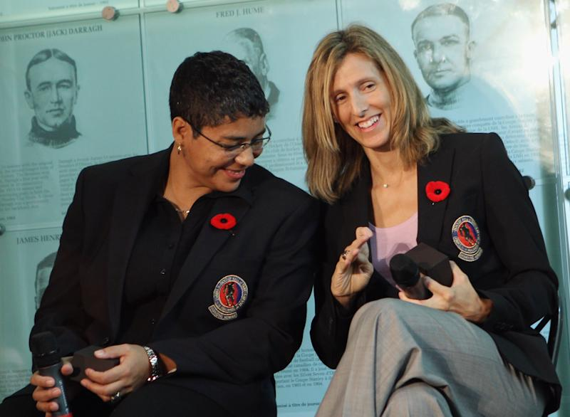 TORONTO, ON - NOVEMBER 08: (L-R) Angela James and Cammi Granato share a moment looking at their new Hall rings at the media opportunity prior to their induction ceremony at the Hockey Hall of Fame on November 8, 2010 in Toronto, Canada. (Photo by Bruce Bennett/Getty Images)