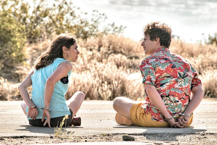 """Carefree Nyles (Andy Samberg, right) and reluctant maid of honor Sarah (Cristin Milioti) have a chance encounter at a wedding and then get stuck in a time loop in the romantic comedy """"Palm Springs."""""""