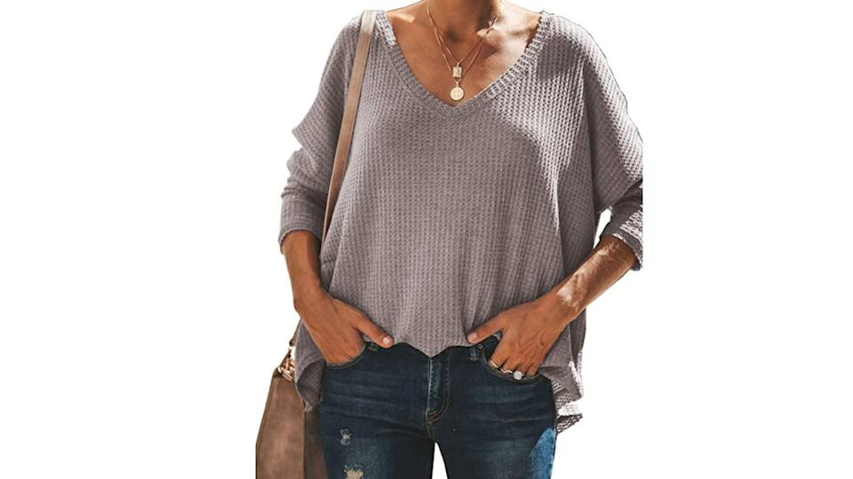 iGENJUN Women's Casual V-Neck Off-Shoulder Batwing Sleeve Pullover. (Image via Amazon)