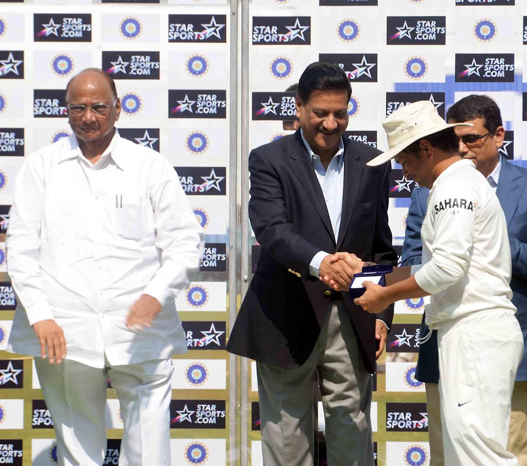 Union Agriculture Minister and Mumbai Cricket Association president Sharad Pawar and Maharashtra Chief Minister Prithviraj Chavan felicitate Cricket legend Sachin Tendulkar at Wankhede stadium in Mumbai on Nov.16, 2013. (Photo: Sandeep Mahankal/IANS)
