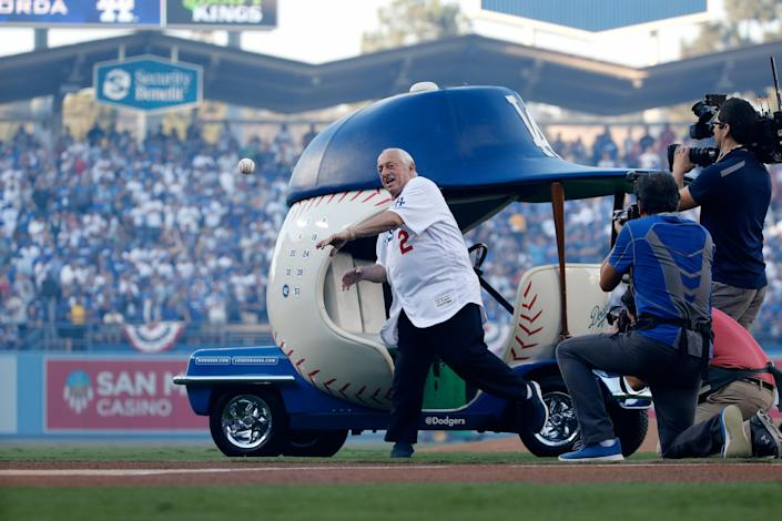 Former Los Angeles Dodgers player and manager Tommy Lasorda throws the ceremonial first pitch prior to Game Three of the 2018 World Series between the Los Angeles Dodgers and the Boston Red Sox at Dodger Stadium on October 26, 2018 in Los Angeles, California. (Photo by Eugene Garcia – Pool/Getty Images)