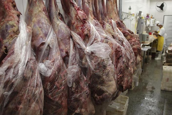 Employees work in a butcher shop in Brasilia, Brazil, Monday, March 20, 2017. The European Union's spokesman in Brazil says the union is temporarily halting some imports of Brazilian meat amid an investigation into a massive scheme of meat adulteration, which involved some of the country's largest producers. (AP Photo/Eraldo Peres)