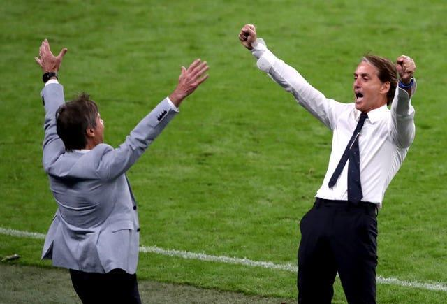 Italy manager Roberto Mancini (right) celebrates victory in their Euro 2020 game at Wembley