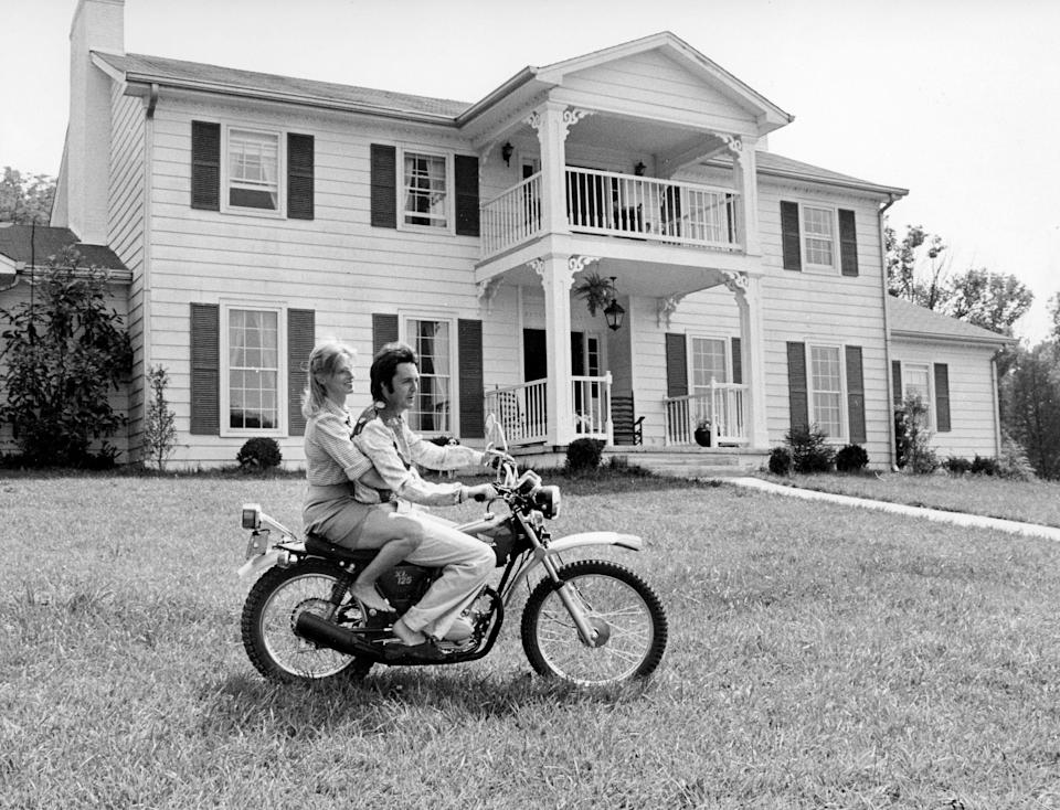 Former Beatle Paul McCartney takes his wife, Linda, for a spin around the lawn of the home of songwriter Curly Putman July 17, 1974, where the McCartneys have been living during their visit to Nashville.