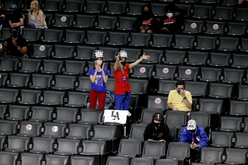 LOS ANGELES, CA - APRIL 18: LA Clippers' fans of LA Clippers guard Reggie Jackson (1) in designated seats in a game against the Minnesota Timberwolves at the Staples Center on Sunday, April 18, 2021 in Los Angeles, CA. (Gary Coronado / Los Angeles Times)