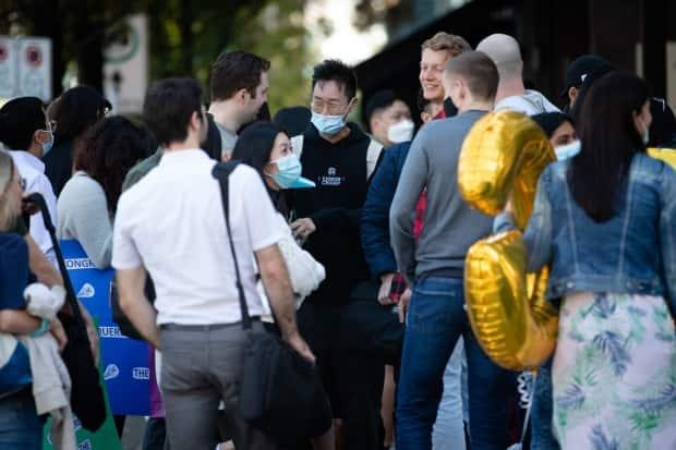 Accounting students wait outside of a restaurant while celebrating the end of their final exam in Vancouver, B.C., on Wednesday, Sept. 15, 2021.  (Maggie MacPherson/CBC - image credit)