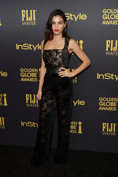 <p>The actress wore a black velvet devoré jumpsuit with a leather belt, featuring gold detailing. She completed the look with a bold lip color and black diamond drop earrings from Established Jewelry. (Photo: Getty Images) </p>