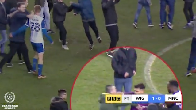 Manchester City star Sergio Aguero has been caught lashing out at a Wigan fan on the picth after their FA Cup loss. Source: Twitter/ BeanymanSports
