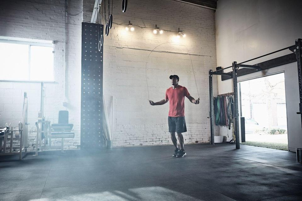 """<p><strong>You'll need: a skipping rope, floor space</strong><br></p><p>Simple in its structure but highly effective, the smart combination of fast-feet skipping and dynamic <a href=""""https://www.menshealth.com/uk/bodyweight-exercises/"""" rel=""""nofollow noopener"""" target=""""_blank"""" data-ylk=""""slk:bodyweight exercises"""" class=""""link rapid-noclick-resp"""">bodyweight exercises</a> in this workout will earn you the <a href=""""https://www.menshealth.com/uk/health/g29724133/boost-metabolism/"""" rel=""""nofollow noopener"""" target=""""_blank"""" data-ylk=""""slk:metabolism"""" class=""""link rapid-noclick-resp"""">metabolism</a>-spiking results you're after, all in a lightning fast 8 minutes. Who honestly hasn't got time for that during self-isolation?</p><p><strong><br>1A) Skipping, 4 rounds</strong><br>Just 15 minutes of skipping can burn more than 250kcal, making it the most efficient conditioning exercise for fat loss at home. Grab a rope and flick it over your head, clearing it with small jumps. After 20 seconds, drop the rope and rest for 10 seconds, then start your squat jumps.<br><strong><br>1B) Squat Jump, 4 rounds</strong><br>To trigger extra calorie burn after skipping, add an explosive jump. Sink down, driving your hips back. Then, as you rise, leap as high as you can), landing in the squat position to go straight into the next rep. After 20 seconds, rest for 10 – that's your first round. Go back to skipping for round two. After your fourth, get ready to move on to the second combo.<br><br><strong>2</strong><strong>A) Skipping, 4 rounds</strong><br>You'll stay with the rope for your second pair but, this time, the bodyweight move will target your arms and core. Stick to the Tabata rule and skip in 20-second bursts; the aim is to perform your jumps at lightning speed, with small, fast rotations. After 20 seconds of work and 10 seconds of rest, put aside the rope and drop down for your press-ups.<br><br><strong>2B) Spiderman Press-Up, 4 rounds</strong><br>Engage your obliques for six-pack definition. """