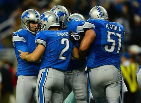Detroit Lions kicker David Akers (2) celebrates with teammate after kicking the game winning extra point during the fourth quarter to defeat the Dallas Cowboys 31-30 at Ford Field. Mandatory Credit: Andrew Weber-USA TODAY Sports