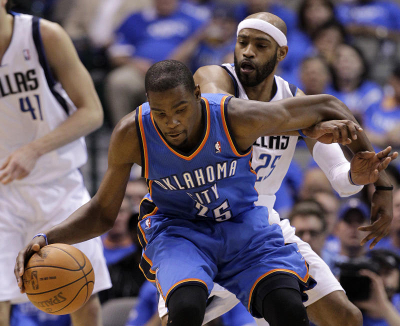 Oklahoma City Thunder's Kevin Durant (35) fights for position against Dallas Mavericks' Vince Carter, rear, in the second half of Game 3 in the first round of the NBA basketball playoffs Thursday, May 3, 2012, in Dallas.  The Thunder won 95-79. (AP Photo/Tony Gutierrez)