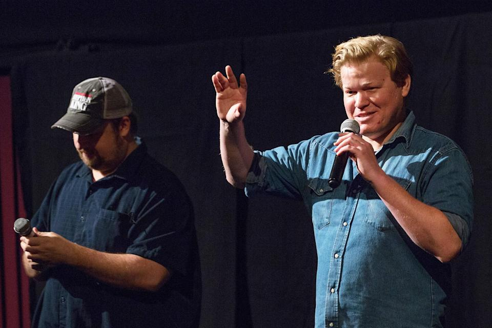 <p>Jesse Plemons (right) and Eric Vespe share a few words at the special screening of <em>Antlers</em> at Alamo Drafthouse on Oct. 11 in Austin, Texas. </p>