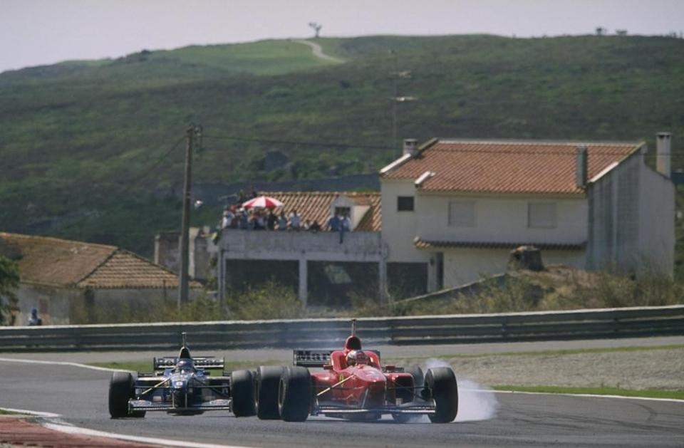 Ferrari's Michael Schumacher is put under pressure by an inspired Jacques Villeneuve of Williams in 1996.