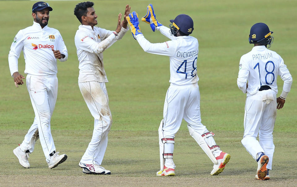 Sri Lanka's Praveen Jayawickrama, second left, celebrates with teammates the dismissal of Bangladesh's Mehidy Hasan during the third day of the second cricket test match between Sri Lanka and Bangladesh in Pallekele, Sri Lanka, Sunday, May 01, 2021.( AP Photo/Sameera Peiris)