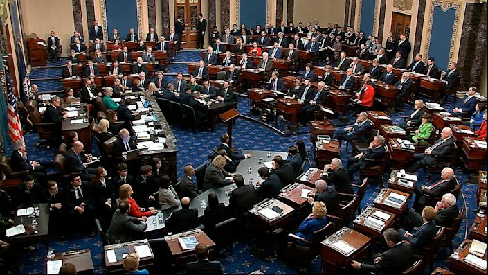 The Senate voting on Trump's first impeachment in February 2020. Sen. Mitt Romney (R-Utah) cast the lone vote to convict by a Republican in the upper left-hand corner. (Photo: Senate Television via AP)