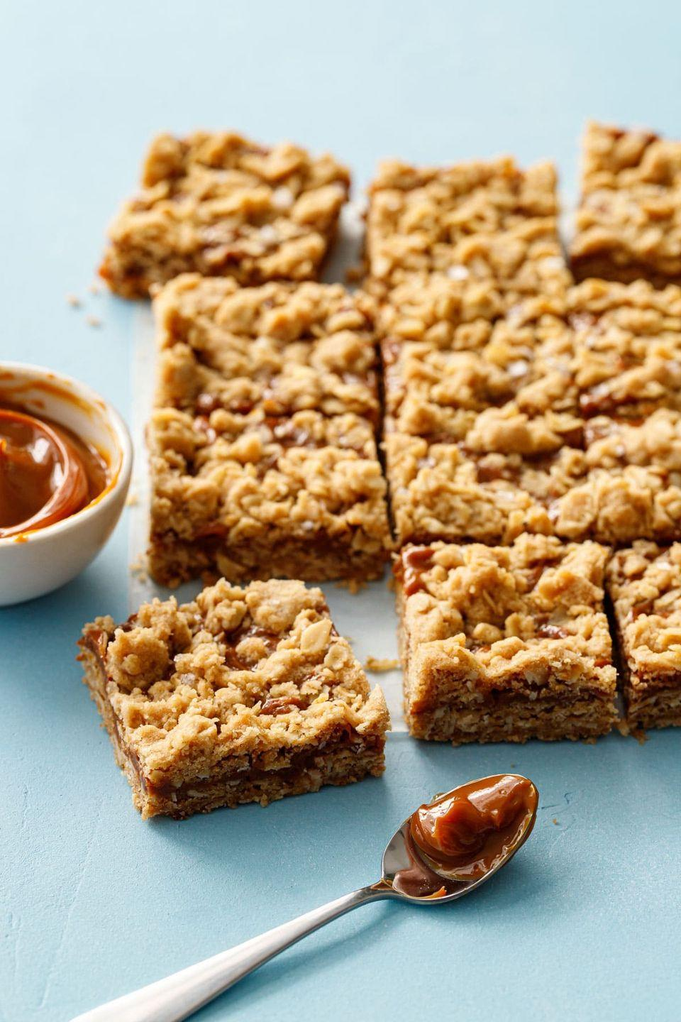 """<p>A crumbly oat cookie topped with a rich and creamy dulce de leche and a sprinkle of sea salt is the ideal sweet and salty treat. </p><p><a href=""""https://www.loveandoliveoil.com/2019/07/dulce-de-leche-oatmeal-crumb-bars.html"""" rel=""""nofollow noopener"""" target=""""_blank"""" data-ylk=""""slk:Get the recipe"""" class=""""link rapid-noclick-resp"""">Get the recipe</a>.</p>"""