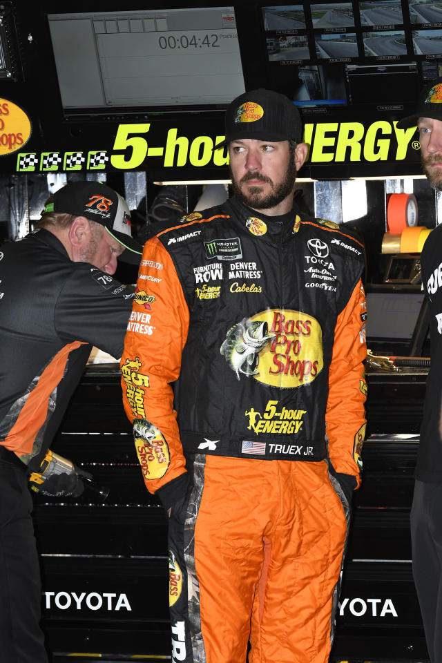 NASCAR Monster Energy Cup Series driver Martin Truex, Jr. stands in the garage area before practice for Sunday's race at Texas Motor Speedway, Saturday, Nov. 3, 2018, in Fort Worth, Texas. (AP Photo/Larry Papke)