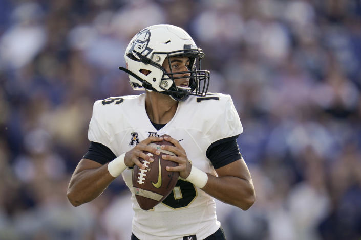 UCF quarterback Mikey Keene looks to pass against Navy during the first half of an NCAA college football game, Saturday, Oct. 2, 2021, in Annapolis, Md. (AP Photo/Julio Cortez)