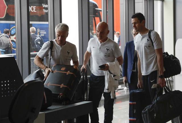 Soccer Football - World Cup - France Departure - Sheremetyevo International Airport, Moscow Region, Russia - July 16, 2018. Coach Didier Deschamps and other team members pass through a security checkpoint before the departure. REUTERS/Sergei Karpukhin