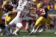 Minnesota running back Treyson Potts (3) avoids a tackle by Bowling Green linebacker Brock Horne (34) during the second half of an NCAA college football game Saturday, Sept. 25, 2021, in Minneapolis. Bowling Green won 14-10. (AP Photo/Stacy Bengs)