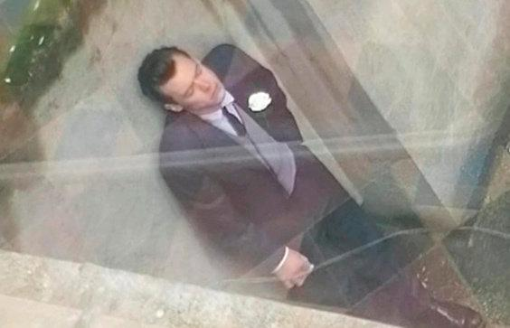 Harry Styles and Emma Corrin have been spotted filming movie 'My Policeman' with the One Direction star chain-smoking - in a wedding suit. (SWNS)