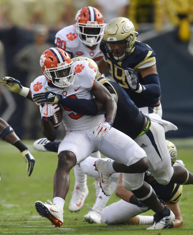 Clemson running back Travis Etienne (9) runs against Georgia Tech during the first half of an NCAA college football game, Saturday, Sept. 22, 2018, in Atlanta. (AP Photo/Mike Stewart)