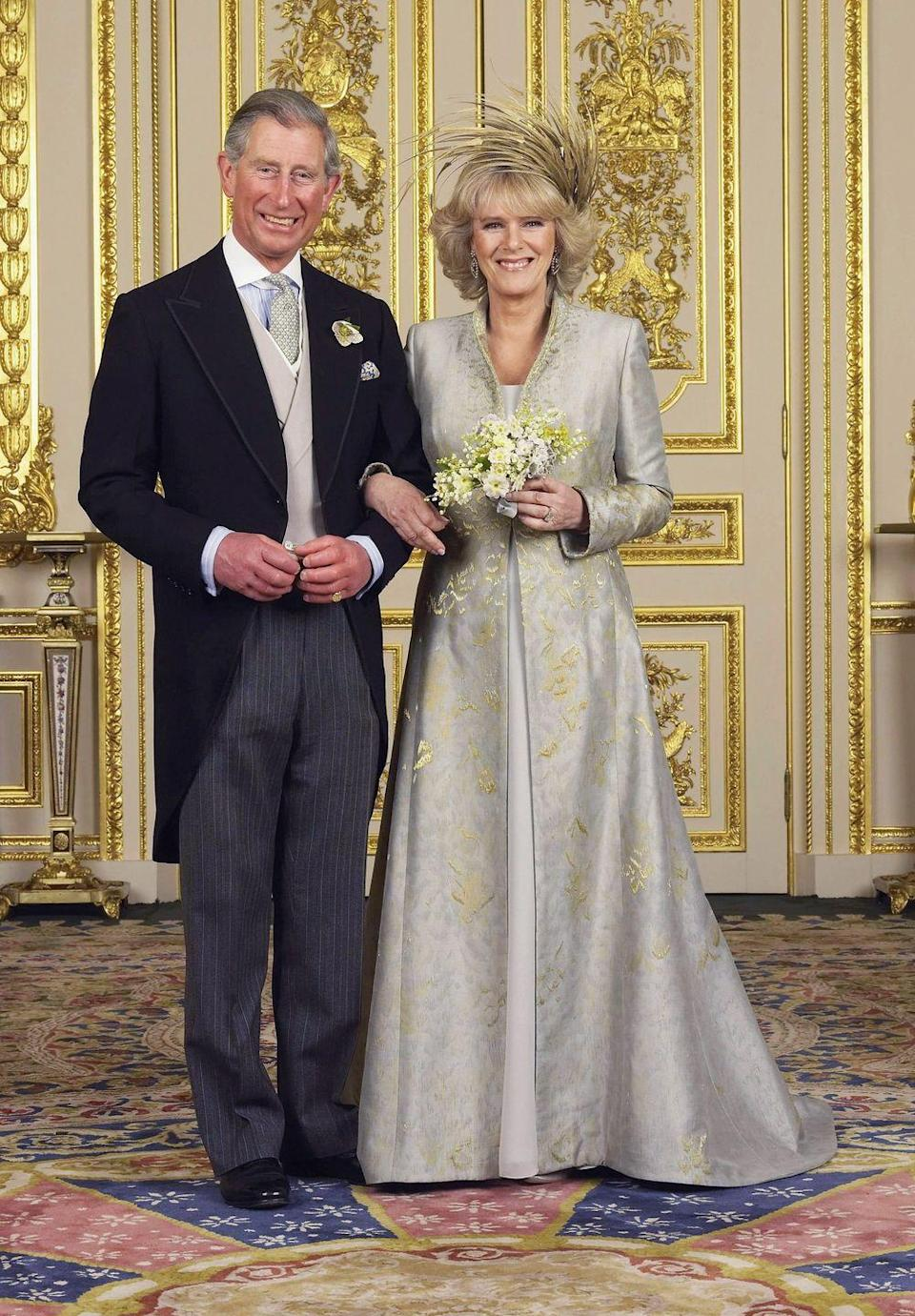 <p>For Camilla Parker Bowles' long-awaited wedding to the apparent heir of the British throne, she wore a light-blue chiffon dress beneath a blue-gold embellished dress coat–both by designer Anne Valentine. Rather than wearing a crown, Camilla went with an intricate headdress made of golden feathers by Ellen Tracey.</p>