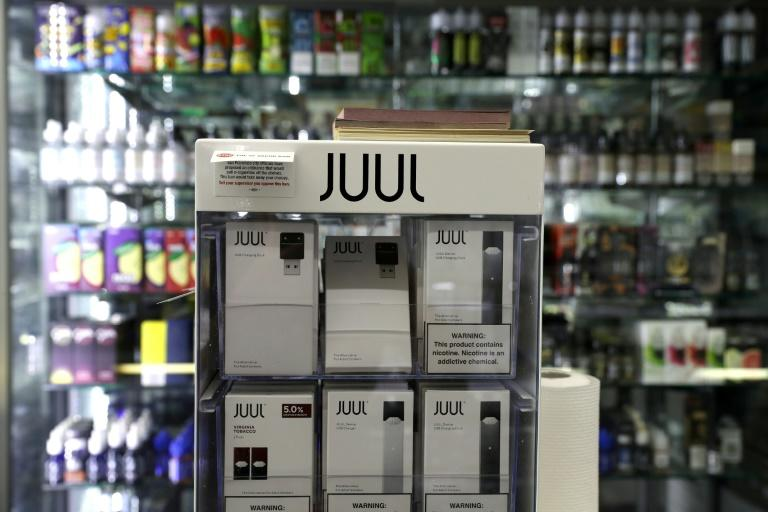 The FDA has warned market-leading e-cigarette maker JUUL to stop advertising itself as a less harmful alternative to smoking, saying the company had broken the law in its marketing (AFP Photo/JUSTIN SULLIVAN)