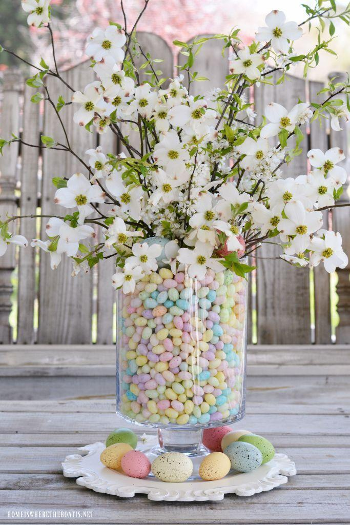 """<p>You're bound to spend time on your Easter tree. Why relegate it to act purely as decoration? </p><p><strong>Get the tutorial at <a href=""""https://homeiswheretheboatis.net/2017/04/14/alfresco-easter-table-blooming-branch-centerpiece/"""" rel=""""nofollow noopener"""" target=""""_blank"""" data-ylk=""""slk:Home Is Where the Heart Is"""" class=""""link rapid-noclick-resp"""">Home Is Where the Heart Is</a>.</strong></p><p><a class=""""link rapid-noclick-resp"""" href=""""https://www.amazon.com/dp/B000FDOSN2/ref=dp_cerb_1?tag=syn-yahoo-20&ascsubtag=%5Bartid%7C10050.g.26498744%5Bsrc%7Cyahoo-us"""" rel=""""nofollow noopener"""" target=""""_blank"""" data-ylk=""""slk:SHOP JELLY BEANS"""">SHOP JELLY BEANS </a></p>"""