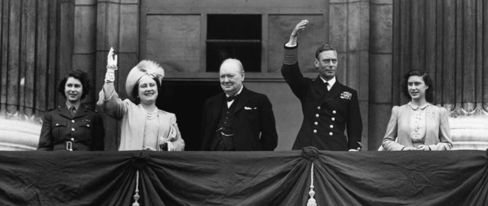 Prime Minister Winston Churchill appears on the balcony at Buckingham Palace together with King George VI and Queen Elizabeth and the two princesses on the afternoon of V-E Day, May 8, 1945. (Photo by CORBIS/Corbis via Getty Images)